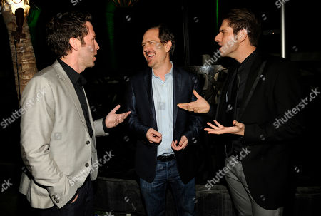 "Josh Stolberg, center, writer/director of ""The Hungover Games,"" mingles with cast members Ben Begley, left, and Ross Nathan at the post-premiere party for the film, in Los Angeles"