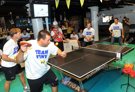 Gold medalists and champion tennis players Bob, far right, and Mike Bryan face off against Captain Tom Spade, left, of Brooklyn's Engine Company 242, and Firefighter Glenn Brown, of Manhattan's Engine Company 1, at the Nesquik FDNY Foundation Charity Ping Pong tournament at SPiN Galactic in New York, . Nesquik donated $25,000 to the FDNY Foundation, supporting fire prevention and health and wellness programs