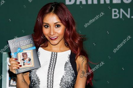"""In this photo, Nicole """"Snooki"""" Polizzi appears at a signing event for her book """"Baby Bumps"""" at Barnes & Noble in New York. Polizzi is expecting baby No. 2. The 26-year-old reality star says in an interview with Us Weekly: I'm due in the fall around my wedding time. Busy year! The pregnancy was confirmed by her publicist. Polizzi and her fiance, Jionni LaValle, are the parents of 19-month-old Lorenzo"""