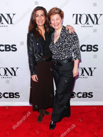 "Jeanine Tesori, left, and Lisa Kron, from ""Fun Home"" attend the 2015 Tony Awards Meet the Nominees press junket in New York. Tesori and Kron can make history when the Tony awards are announced next month. If they win, the pair will become the first female writing team to nab a Tony for best musical score"