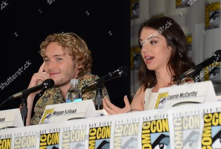 "Toby Regbo, left, and Adelaide Kane attend the ""Reign"" panel on Day 1 of Comic-Con International, in San Diego"