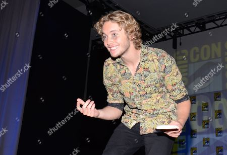"Toby Regbo attends the ""Reign"" panel on Day 1 of Comic-Con International, in San Diego"
