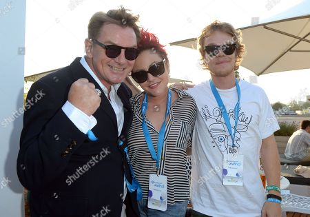 Cathal Smyth AKA Chas Smash from the group Madness, Alfie Allen and Jaime Winstone in the VIP Lounge at Barclaycard presents British Summer Time in Hyde Park, London, on