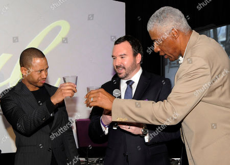 Terrence J, left, toasts with basketball legend Dr. J, right, as Stephen Wilson leads a whisky tasting at the Crown Royal Reign On launch party during All-Star weekend, in Houston. Reign On is Crown Royal's new advertising campaign released this week