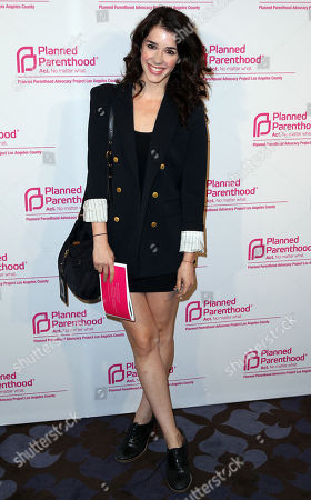 """Stock Photo of Erica Dasher poses for a photo at Planned Parenthood Advocacy Project's """"Politics, Sex, and Cocktails"""" event on Thursday, Oct. 3, in West Hollywood, Calif"""