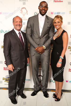 Ron Book, Chairman of Lauren's Kids, LeBron James, of the Miami Heat and Lauren Book, Founder and CEO of Lauren's Kids, attend the 8th Annual Reid & Fiorentino Call of the Game Dinner Presented by Publix on at the Seminole Hard Rock Hotel & Casino in Hollywood, Fla