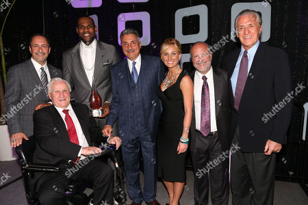 Don Shula Sports Legend Award Honoree, LeBron James, of the Miami Heat, poses with Eric Reid, Miami Heat Broadcaster, left, Don Shula, Tony Fiorentino, Miami Heat Broadcaster, Lauren Book, Founder and CEO of Lauren's Kids, Ron Book, Chairman of Lauren's Kids and Pat Riley, President of the Miami Heat, during the 8th Annual Reid & Fiorentino Call of the Game Dinner Presented by Publix on at the Seminole Hard Rock Hotel & Casino in Hollywood, Fla