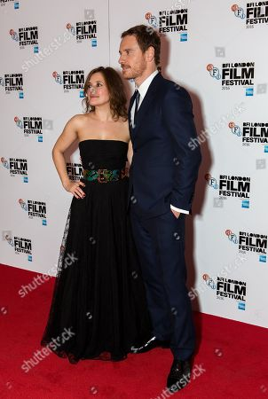 Actors Lyndsey Marshal, left, and Michael Fassbender pose for photographers on arrival at the premiere of the film 'Trespass Against Us', showing as part of the London Film Festival in London