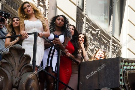 """Fifth Harmony members, from left, Ally Brooke Hernandez, Dinah Jane Hanse, Normani Kordei, Lauren Jauregui and Camila Cabello watch the world premiere of their new video """"Hotel Transylvania 2"""" at the Hard Rock Cafe, in New York"""