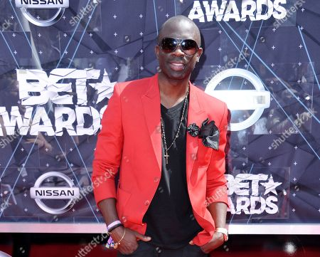 Sam Sarpong arrives at the BET Awards at the Microsoft Theater, in Los Angeles. The London-born model and TV actor Sarpong has died in Southern California after jumping to his death from a bridge. Sarpong, who was 40, died Monday afternoon, Oct. 26, 2015, in Pasadena, where he lived