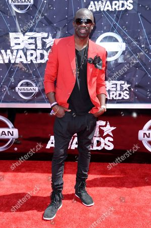Stock Image of Sam Sarpong arrives at the BET Awards at the Microsoft Theater, in Los Angeles. The London-born model and TV actor Sarpong has died in Southern California after jumping to his death from a bridge. Sarpong, who was 40, died Monday afternoon, Oct. 26, 2015, in Pasadena, where he lived