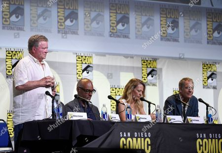 """William Shatner, from left, Michael Dorn, Jeri Ryan, and Scott Bakula honor Anton Yelchin and Leonard Nimoy with a moment of silence at the """"Star Trek"""" panel on day 3 of Comic-Con International, in San Diego"""