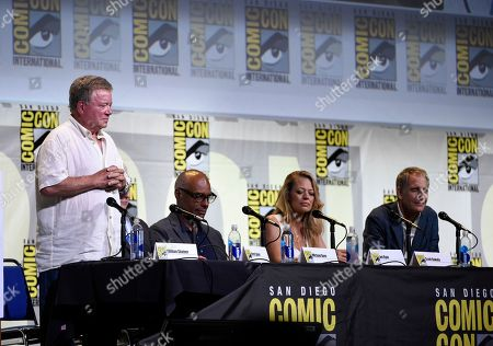 """Stock Picture of William Shatner, from left, Michael Dorn, Jeri Ryan, and Scott Bakula honor Anton Yelchin and Leonard Nimoy with a moment of silence at the """"Star Trek"""" panel on day 3 of Comic-Con International, in San Diego"""