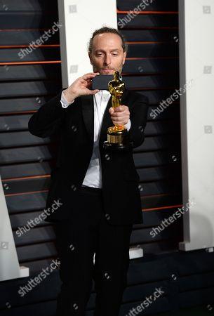 Emmanuel Lubezki arrives at the Vanity Fair Oscar Party, in Beverly Hills, Calif