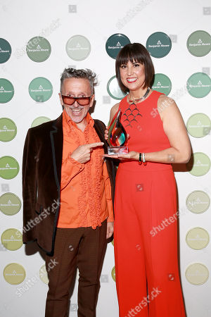Stock Photo of IMAGE DISTRIBUTED FOR BENJAMIN MOORE - Simon Doonan, Creative Ambassador-at-Large of Barneys New York, presents fashion designer Trina Turk with the inaugural CFDA Trailblazer Award at the 2014 Benjamin Moore HUE Awards on at the Highline Ballroom in New York