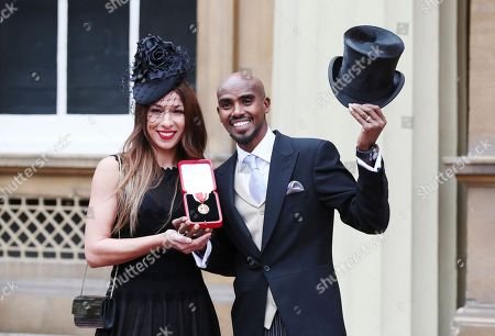 Stock Picture of Four-time Olympic gold medalist Mo Farah poses for a photo, with his wife Tania, left, after he was awarded a Knighthood by Britain's Queen Elizabeth II at an Investiture ceremony at Buckingham Palace in London, . Farah is the most successful British distance runner track athlete in modern Olympic Games history
