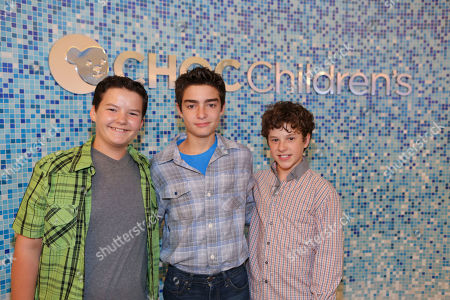 """From left, actor Aedin Mincks, CJ George, Hyundai Hope on Wheels Ambassador and actor Noland Gould pose during """"Every Handprint Has A Story"""" Hyundai Hope on Wheels handprint ceremony at CHOC Children's Hospital, in Orange, Calif"""