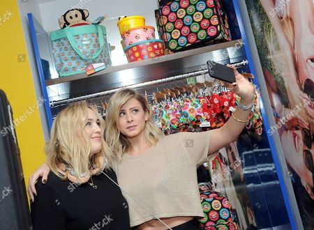 Stock Image of TV personality and fashion blogger Lo Bosworth, right, hangs out with DJ Jilly Hendrix at the Paul Frank pop-up shop, in New York