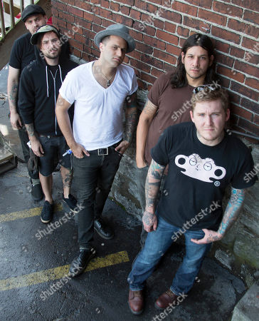 "From right, Brian Fallon, Benny Horowitz, Alex Levine, Alex Rosamilia, and Ian Perkins, of the musical group, The Gaslight Anthem, pose for a portrait at the Cannery Ballroom, in Nashville, Tenn. The band relocated to Nashville in February 2012 and hooked up with Grammy-winning producer, Brendan O'Brien, at Blackbird Studios, to work on their new album, ""Handwritten"