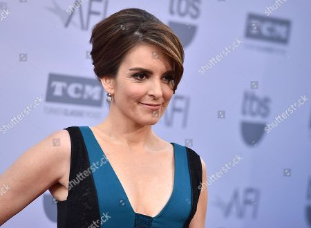 Tina Fey arrives at the 43rd AFI Lifetime Achievement Award Tribute Gala at the Dolby Theatre in Los Angeles. Fey returned to Saturday Night Live to reprise her impression of Sarah Palin and give a rambling, sometimes-rhyming endorsement to Donald Trump. The sketch kicked off the cold open to SNL, with Fey and Darrell Hammond skewering the former Alaska governor's endorsement speech in Iowa on Tuesday