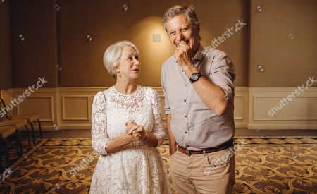 "Stock Picture of Helen Mirren and Lasse Halstrom share a laugh during press day for ""The Hundred Year Journey"" at The Four Seasons, in Beverly Hills, Calif"