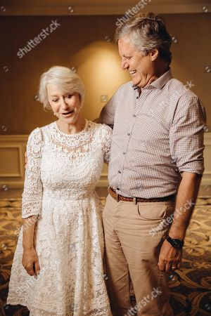 "Stock Image of Helen Mirren and Lasse Halstrom share a laugh during press day for ""The Hundred Year Journey"" at The Four Seasons, in Beverly Hills, Calif"