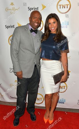Kenny Smith and wife Gwendolyn Osborne walk the red carpet at Smith's Crown Royal XO All-Star Weekend party, in New Orleans, La