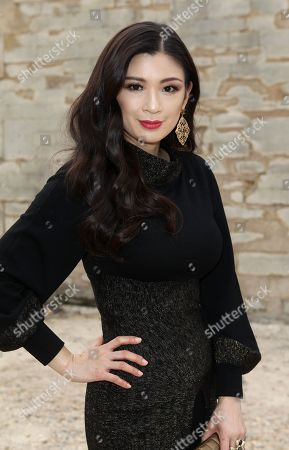 Stock Photo of IMAGE DISTRIBUTED FOR RWE - Producer Rebecca Wang attends Elie Saab Fall-Winter 2013-2014 fashion collection at Paris Fashion week on