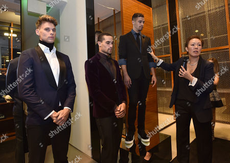 Stylist Jeanne Yang, right, speaks at the Saks' Men's Formal Wear Shop Opening, in Beverly Hills, Calif