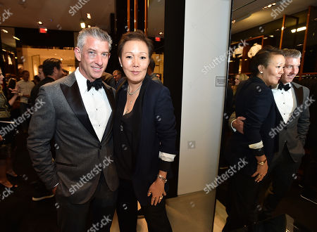 John McIlwee, left, and Jeanne Yang attend the Saks' Men's Formal Wear Shop Opening, in Beverly Hills, Calif