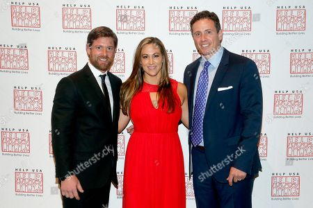 From left, disabled Iraq veteran and Dancing With the Stars finalist Noah Galloway, his fiance Jamie Boyd and CNN News anchor Chirs Cuomo attend the 2015 Help USA Hero Awards Dinner at Cipriani 42nd Street on Thurs., in New York City