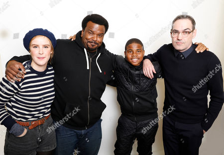 """Stock Photo of From left, actors Carla Juri, Craig Robinson, and Markees Christmas pose with filmmaker Chad Hartigan for a portrait to promote the film, """"Morris From America"""", at the Toyota Mirai Music Lodge during the Sundance Film Festival on in Park City, Utah"""