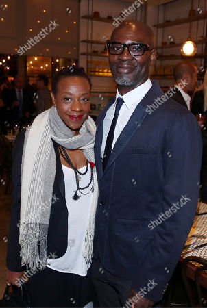 Marianne Jean-Baptiste, left, and Evan Williams pose for a photo at LA Chefs for Human Rights at Cassia in Santa Monica, Calif. on