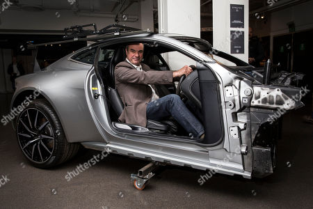 British special effects coordinator Chris Corbould sits in the ejector seat of an Aston Martin, as the vehicles used in the filming of new Bond film Spectre join the largest collection of 007 vehicles in the world, at the London Film Museum, London
