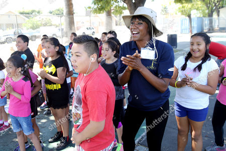 Olympian Tasha Danvers, center, works with LAUSD students during Ready, Set, Gold! Day sponsored by Samsung at Trinity Street Elementary on in Los Angeles