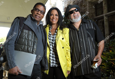 Musicians Herbie Hancock, left, Sheila E, center, and Poncho Sanchez, who all will be performing at this year's Playboy Jazz Festival, pose together before a news conference at the Playboy Mansion on in Los Angeles. The 35th Anniversary Playboy Jazz Festival will be held at the Hollywood Bowl on June 15 and 16