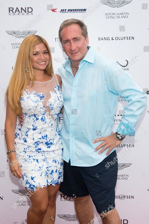 Stock Picture of Karen Koeningsberg (L) and Bradford Rand attend the Hamptons Brunch with Aston Martin in Water Mill on in New York