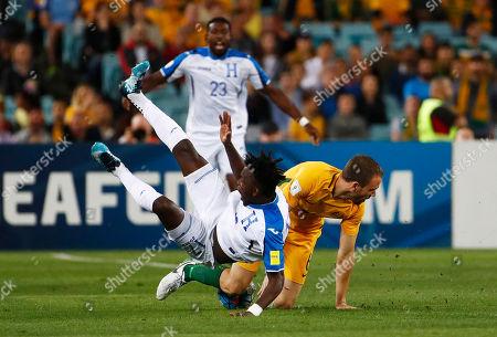 Alberth Elis, Matthew Jurman. Honduras' Alberth Elis is fouled by Australia's Matthew Jurman during their World Cup soccer playoff deciding match in Sydney, Australia