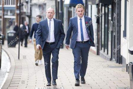 Stock Photo of Corpus Christi Catholic school head teacher Steve Moat (left) & teacher Andrew Kellett (right) arrive for the third day of the Ann Maguire inquest at Wakefield Coroners Court