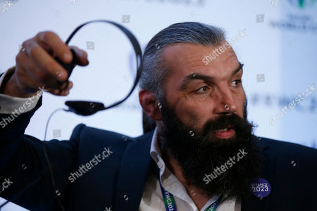 Retired Rugby player, Sebastien Chabal, France 2023 leader and bid Ambassador gestures, during a TV interview, after France were announced as winners of the right to host the Rugby World Cup in 2023, at a hotel in London, . France will host the Rugby World Cup in 2023, a year before the Olympic Games in Paris, after surprisingly beating South Africa and Ireland in a vote on Wednesday