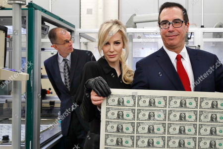 Steven Mnuchin, Louise Linton, Leonard Olijar. Treasury Secretary Steven Mnuchin, right, and his wife Louise Linton, hold up a sheet of new $1 bills, the first currency notes bearing his and U.S. Treasurer Jovita Carranza's signatures, at the Bureau of Engraving and Printing (BEP) in Washington. The Mnuchin-Carranza notes, which are a new series of 2017, 50-subject $1 notes, will be sent to the Federal Reserve to issue into circulation. At left is BEP Director Leonard Olijar