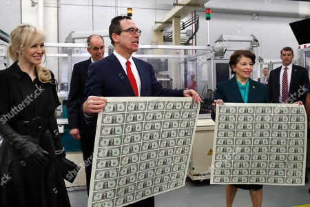 Steven Mnuchin, Jovita Carranza, Louise Linton, Leonard Olijar. Treasury Secretary Steven Mnuchin, with his wife Louise Linton, at far left, and U.S. Treasurer Jovita Carranza, right, hold up sheets of new $1 bills, the first currency notes bearing Mnuchin and Carranza's signatures, at the Bureau of Engraving and Printing in Washington. The Mnuchin-Carranza notes, which are a new series of 2017, 50-subject $1 notes, will be sent to the Federal Reserve to issue into circulation. Behind Mnuchin is BEP Director Leonard Olijar