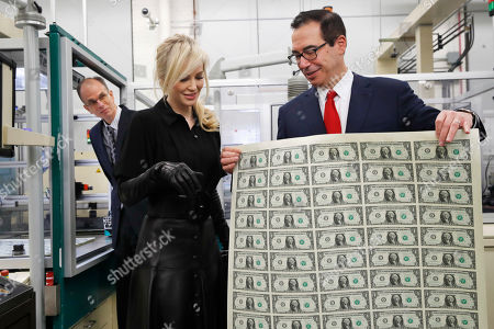 Steven Mnuchin, Louise Linton, Leonard Olijar. Treasury Secretary Steven Mnuchin, right, shows his wife Louise Linton a sheet of new $1 bills, the first currency notes bearing his and U.S. Treasurer Jovita Carranza's signatures, at the Bureau of Engraving and Printing (BEP) in Washington. The Mnuchin-Carranza notes, which are a new series of 2017, 50-subject $1 notes, will be sent to the Federal Reserve to issue into circulation. At left is BEP Director Leonard Olijar