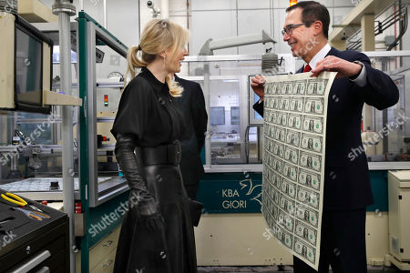 Steven Mnuchin, Louise Linton. Treasury Secretary Steven Mnuchin, right, and his wife Louise Linton, left, react as Mnuchin holds up a sheet of new $1 bills, the first currency notes bearing his and U.S. Treasurer Jovita Carranza's signatures, at the Bureau of Engraving and Printing in Washington. The Mnuchin-Carranza notes, which are a new series of 2017, 50-subject $1 notes, will be sent to the Federal Reserve to issue into circulation