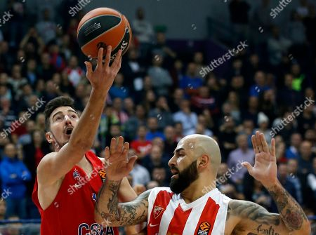 CSKA Moscow's Nando De Colo, left, jumps to score a basket as Red Star's Pero Antic tries to stop him tries to block him during their Euroleague basketball match in Belgrade, Serbia