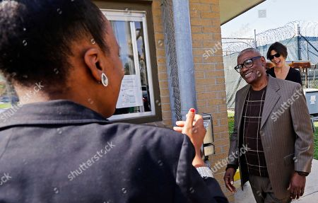Wilbert Jones, right, is greeted by family members and attorneys as he leaves East Baton Rouge Parish Prison in Baton Rouge, La., . Jones, who has spent nearly 50 years in prison was freed after a judge overturned his conviction in the kidnapping and rape of a nurse. State District Court Judge Richard Anderson threw out Jones' conviction on Oct. 31, saying authorities withheld evidence that could have exonerated Jones decades ago