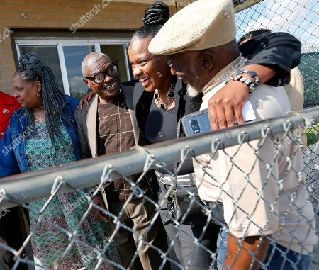 Wilbert Jones, Wilda Jones, Plem Jones, Wajeedah Jones. Wilbert Jones, second left, hugs family members and attorneys as he leaves East Baton Rouge Parish Prison in Baton Rouge, La., . Left is sister-in law Wilda Jones, right is brother Plem Jones, and second right is niece Wajeedah Jones. The Louisiana man who has spent nearly 50 years in prison was freed after a judge overturned his conviction in the kidnapping and rape of a nurse. State District Court Judge Richard Anderson threw out Jones' conviction on Oct. 31, saying authorities withheld evidence that could have exonerated Jones decades ago