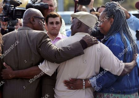 Wilbert Jones, Wilda Jones, Plem Jones. Wilbert Jones, left, embraces his brother brother Plem Jones, center, and sister-in law Wilda Jones, right, after leaving East Baton Rouge Parish Prison in Baton Rouge, La., . Wilbert Jones, who has spent nearly 50 years in prison was freed after a judge overturned his conviction in the kidnapping and rape of a nurse. State District Court Judge Richard Anderson threw out Jones' conviction on Oct. 31, saying authorities withheld evidence that could have exonerated Jones decades ago