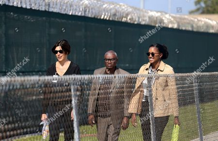 Wilbert Jones, Emily Maw, Kia Hayes. Wilbert Jones leaves East Baton Rouge Parish Prison with Emily Maw, director of Innocence Project New Orleans, left, and Kia Hayes, IPNO staff attorney, in Baton Rouge, La., . Jones, who has spent nearly 50 years in prison was freed after a judge overturned his conviction in the kidnapping and rape of a nurse. State District Court Judge Richard Anderson threw out Jones' conviction on Oct. 31, saying authorities withheld evidence that could have exonerated Jones decades ago
