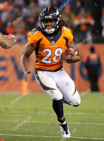Denver Broncos running back Jamaal Charles (28) runs against the New England Patriots during the second half of an NFL football game, in Denver